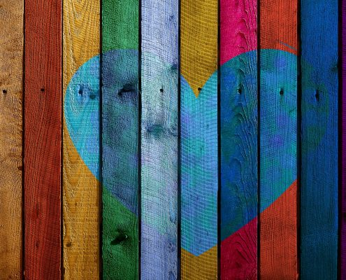 wood coating used in different colours to make a heart on a wall
